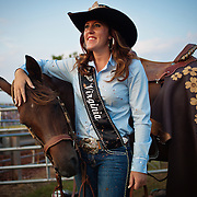 "Melissa McMullan, Miss Rodeo Virginia 2014, of Ft. Valley, VA, stands with her horse, Sarah, during the Dave Martin Rodeo, at the Prince William County Fair, in Manassas, VA, on Sunday, August 10, 2014.  McMullan represents Virginia regionally and nationally, while promoting ""rodeos and the western lifestyle"" in Virginia. For The Prince William Times"