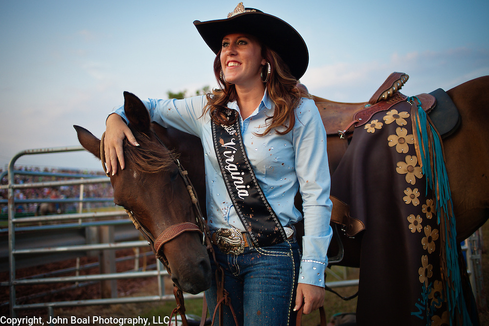 """Melissa McMullan, Miss Rodeo Virginia 2014, of Ft. Valley, VA, stands with her horse, Sarah, during the Dave Martin Rodeo, at the Prince William County Fair, in Manassas, VA, on Sunday, August 10, 2014.  McMullan represents Virginia regionally and nationally, while promoting """"rodeos and the western lifestyle"""" in Virginia. For The Prince William Times"""