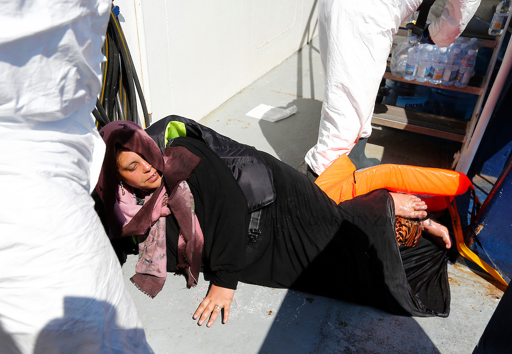 A migrant lies on the deck after being pulled onto the Migrant Offshore Aid Station (MOAS) ship MV Phoenix after being rescued from an overloaded wooden boat 10.5 miles off the coast of Libya August 6, 2015.  An estimated 600 migrants on the boat were rescued by the international non-governmental organisations Medecins san Frontiere (MSF) and MOAS without loss of life on Thursday afternoon, a day after more than 200 migrants are feared to have drowned in the latest Mediterranean boat tragedy after rescuers saved over 370 people from a capsized boat thought to be carrying 600.<br /> REUTERS/Darrin Zammit Lupi <br /> MALTA OUT. NO COMMERCIAL OR EDITORIAL SALES IN MALTA
