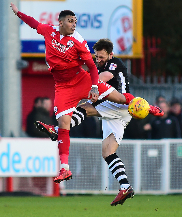 Crawley Town's Karlan Ahearne-Grant vies for possession with Lincoln City's Neal Eardley<br /> <br /> Photographer Andrew Vaughan/CameraSport<br /> <br /> The EFL Sky Bet League Two - Crawley Town v Lincoln City - Saturday 17th February 2018 - Broadfield Stadium - Crawley<br /> <br /> World Copyright © 2018 CameraSport. All rights reserved. 43 Linden Ave. Countesthorpe. Leicester. England. LE8 5PG - Tel: +44 (0) 116 277 4147 - admin@camerasport.com - www.camerasport.com