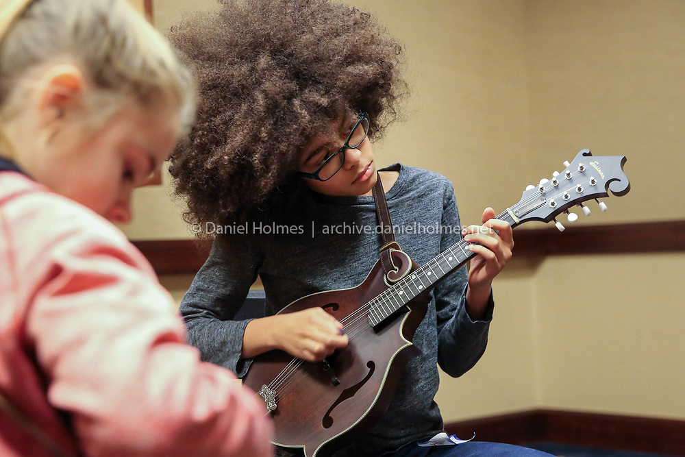 (2/17/18, FRAMINGHAM, MA) Horace DePreist-Sullivan, 11, of New York, plays the mandolin during the Joe Val Bluegrass Festival at the Framingham Sheraton on Saturday. [Daily News and Wicked Local Photo/Dan Holmes]