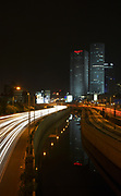Israel, Tel Aviv, Long exposure Night shot of Ayalon highway Azrieli high rises on the right