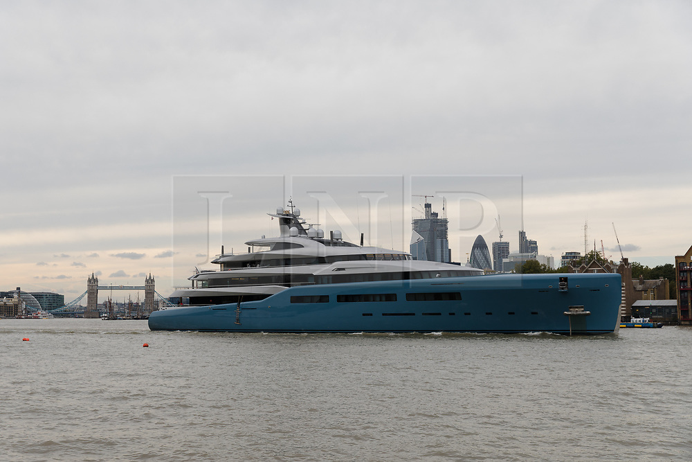 © Licensed to London News Pictures. 12/09/2018. London, UK.  Billionaire Spurs owner, Joe Lewis's 321 feet long luxury superyacht Aviva leaves London passing Tower Bridge and skyscrapers on the River Thames following a London visit. Aviva, worth an estimated £113m is one of a growing number of superyachts to visit the capital this year and moored near Butlers Wharf for a number of weeks, during which wealthy homeowners criticised the Spurs owner for spoiling their river view.  Photo credit: Vickie Flores/LNP