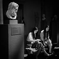 The Greek hero Herakles, watches the modern young ladies with bemusement at the Metropolitan Museum of Art. (Roman, Imperial period, 1st century A.D. Copy of a Greek statue of the second half of the 4th century B.C. attributed to Lysippos.)
