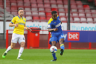 AFC Wimbledon attacker Zach Robinson (14) shoots at goal from Brighton and Hove Albion midfielder Andrew Crofts (48) during the EFL Trophy Southern Group G match between AFC Wimbledon and Brighton and Hove Albion U21 at The People's Pension Stadium, Crawley, England on 22 September 2020.
