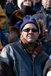 Man in Chicago Bears tobaggan watching inauguration of Barack Obama from front steps of Lincoln Memorial, Washington D.C., USA.