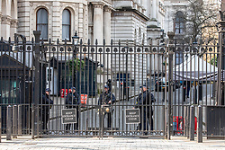 © Licensed to London News Pictures. 27/03/2020. London, UK. Armed police guard Downing Street as Prime Minister Boris Johnson reveals he has contracted coronavirus and is in self-isolation as the coronavirus crisis continues. Photo credit: Alex Lentati/LNP