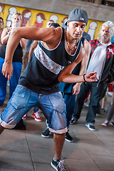 "(c)Licensed to London News Pictures. 27/07/2014. London. England. Dancers and audience at The Bridge, an annual event celebrating hip-hop culture organised by Scanners Inc under Hungerford Bridge at London's South Bank. Kate Scanlan of Scanners Inc says ""It's about all ages and nationalities having fun and showing what hip hop culture can be. People here have known each other for 40 years and now their kids are dancing, that makes me really happy to facilitate it. Next year we are planning to run it 4 times, each with different themes."" Photo credit Carole Edrich/LNP"