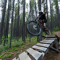 Chris hitting a jump on Race of Spades at Moose Mountain in Alberta, Canada