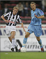 CHARLEROI 04/09/2004 / <br /> SPORT / FOOTBALL / VOETBAL<br /> STADE DU PAYS DE CHARLEROI<br /> CHARLEROI - CLUB BRUGGE<br /> RUNE LANGE - THIBAUT DETAL