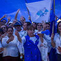 Supporters of National Party candidate Juan Orlando Hernandez shouted their slogan 'four years more' and made a four-finger-salute as they marched in Tegucigalpa. Videos circulated on social media shortly afterwards showing that many of those on the march had been paid 50 Lempiras to attend.