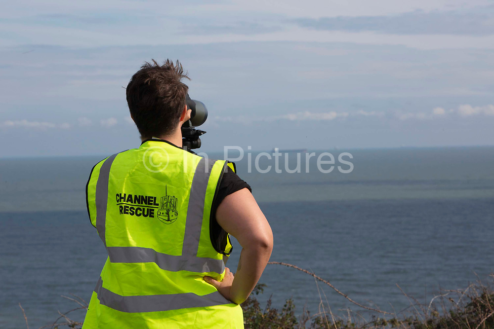 A group of Channel Rescue volunteers monitor the English Channel using telescopes and binoculars searching for small boats of people migrating across from France and mainland Europe on the 29th of September 2020 on the White Cliffs of Dover, United Kingdom. Formed in the summer of 2020 Channel Rescue are Human Rights Observers concerned about the demonisation of the men, women, and children migrating across the English Channel risking their lives to arrive on the UK shores.