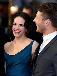Jessica Brown Findlay (left) and Glen Powell attending the world premiere of The Guernsey Literary and Potato Peel Pie Society at the Curzon Mayfair, London. Photo credit should read: Doug Peters/EMPICS Entertainment