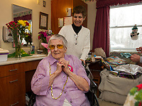 Helen Clark is ready to greet her party guests with her daughter in law Liz Clark at Genesis Rehab in celebration of her 100th birthday.  (Karen Bobotas/for the Laconia Daily Sun)
