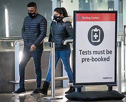 © Licensed to London News Pictures. 15/02/2021. London, UK. Travellers leave a COVID-19 test centre at Heathrow Airport Terminal 2 in London. New quarantine measures being introduced from today mean that any travellers form red list countries will be required to isolate for ten days in a hotel at a cost of £1,750 per person.  Photo credit: Ben Cawthra/LNP