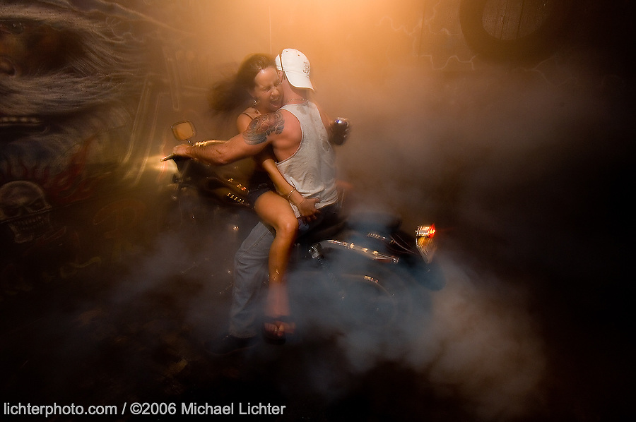 Hold On. The Burnout Pit at SBB, Myrtle Beach, SC. 2006<br /> <br /> Limited Edition Print from an edition of 50. Photo ©2006 Michael Lichter.<br /> <br /> Hold On (he said!). I swear, this girl had never been on a bike in her life!!!