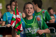 """A boy carries the baton as he runs on the 20th Korrika. Erratzu (Basque Country) April 3, 2017. The """"Korrika"""" is a relay course, with a wooden baton that passes from hand to hand without interruption, organised every two years in a bid to promote the basque language. The Korrika runs over 11 days and 10 nights, crossing many Basque villages and cities, totalling some 2300 kilometres. Some people consider it an honour to carry the baton with the symbol of the Basques, """"buying"""" kilometres to support Basque language teaching. (Gari Garaialde / Bostok Photo)"""
