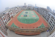 SHAOXING, CHINA - <br /> <br /> Rooftops With A Wide Variety Of Uses Around China<br /> <br /> After the story from China Last week on A Chinese man has spent six years building his dream mountaintop villa - on top of a Beijing apartment block.  we show how you can get away with making the most of your roof top with these legal designs...<br /> <br /> Students do exercise during a PE class at a rooftop playground at Nanmen Middle School in Putian, Fujian Province of China.<br /> ©Exclusivepix