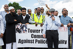 London, UK. 12 July, 2019. John Biggs, the Labour Mayor of Tower Hamlets, addresses a protest during which he was criticised by local community members close to the site where Younis Bentahar, aged 38, was violently arrested by Metropolitan Police officers on 10th July following a 5-stage warning. The incident, during which Mr Bentahar appeared to be having a seizure, has since been referred to the Metropolitan Police's Central East Command Professional Standards Unit after a video of the arrest went viral on social media. Mr Bentahar was filmed being struck with handcuffs and pinned down by police officers after he had stopped on a single yellow line with a disabled badge displayed and ignored the five-stage warning.
