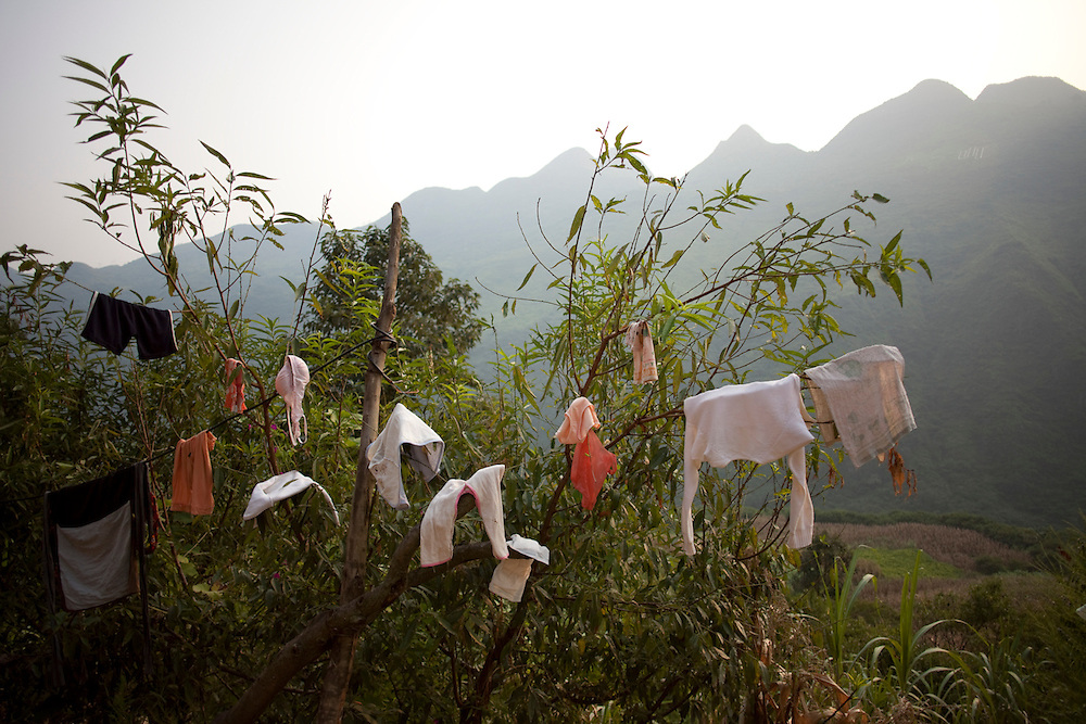 Clothes hung out to dry in the afternoon sun in Manzhai village.