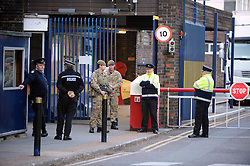 © Licensed to London News Pictures. 22/05/2013.Woolwich 'terrorist attack': One dead and two seriously injured. Woolwich Barracks,Woolwich. Police outside Woolwich Barracks with armed soldiers..Photo credit :Grant Falvey/LNP