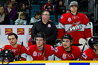 KAMLOOPS, CANADA - NOVEMBER 5:  Athletic trainer Colin Robinson stands on the bench next to David Tendeck #30, and behind Calen Addison #3, Scott Walford #7 and Jett Woo #4 of Team WHL on November 5, 2018 at Sandman Centre in Kamloops, British Columbia, Canada.  (Photo by Marissa Baecker/Shoot the Breeze)