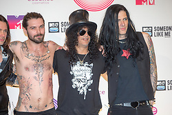 Simon Neil and Slash with the rest of the band, backstage at the winners room MTV EMA, Glasgow.