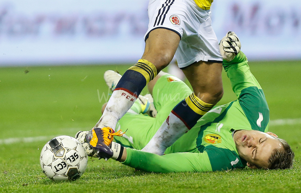 (From L-R)  Falcao Garcia of Colombia scores past goalkeeper Simon Mignolet of Belgium during the friendly soccer match between Belgium and Colombia, at the King Baudouin stadium, in Brussels, Belgium, 14 November 2013.