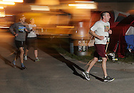Augusta, New Jersey - Runners on the course at night in 6-, 12-, 24- and 72-hour races during the 3 Days at the Fair races at Sussex County Fairgrounds on May 12, 2012.