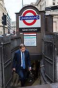 A British male walks up the steps of the subway to leave London Underground Bank Station, United Kingdom.  Bank station opened in 1900 and is named after the Bank of England.  It is served by the Central, Northern and Waterloo and City lines.  Due to is central City of London location, the station complex is the ninth-busiest on the London Underground network.