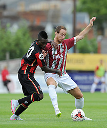 Exeter City's Ryan Harley challenges for the ball with Bournemouth's Christian Atsu. - Photo mandatory by-line: Harry Trump/JMP - Mobile: 07966 386802 - 18/07/15 - SPORT - FOOTBALL - Pre Season Fixture - Exeter City v Bournemouth - St James Park, Exeter, England.