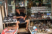 Seller asleep at Dongtai Lu antique market in Shanghai, China