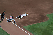 Brian Dozier #2 of the Minnesota Twins slides safely into 3rd base for a triple against the Miami Marlins in Game 1 of a split doubleheader on April 23, 2013 at Target Field in Minneapolis, Minnesota.  The Twins defeated the Marlins 4 to 3.  Photo: Ben Krause