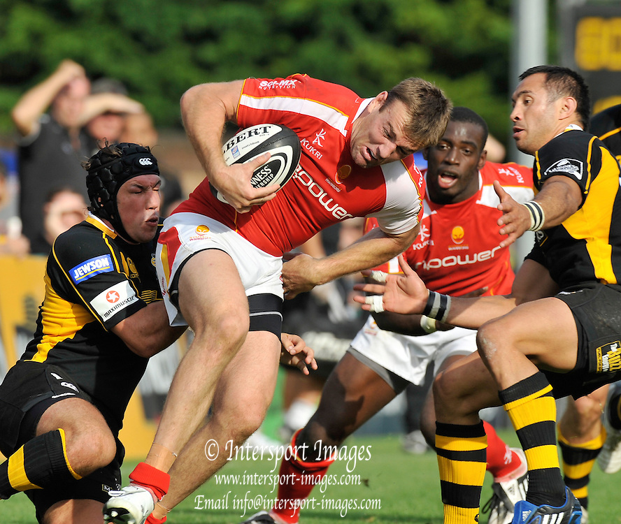 Wycombe, GREAT BRITAIN,  Warriors, Chris LATHAM, attacking with the ball, tackled left by Wasps Tom VOYCE and right Riki FLUTEY, during the Guinness Premiership match,  London Wasps vs Worcester Warriors at Adam's Park Stadium, Bucks on Sun 14.09.2008. [Photo, Peter Spurrier/Intersport-images]
