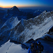 Peter Whittaker and Tendi Sherpa ascend the Southeast Ridge of Everest, just below the South Summit, at sunrise with the Eddie Bauer/First Ascent 2009 Return to Everest Expedition.