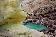 Turquoise crater lake at the Kawah Ijen Sulphur Mines in East Java, Indonesia, Southeast Asia