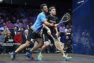 Omar Mosaad of Egypt (wearing light Blue shirt) collides into Mathieu Castagnet of France (wearing Black shirt) during the Final, Omar Mosaad of Egypt v Mathieu Castagnet of France , Canary Wharf Squash Classic 2016 , at the East Wintergarden in Canary Wharf , London on Friday 11th March 2016.<br /> pic by John Patrick Fletcher, Andrew Orchard sports photography.