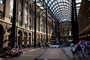 Hayes Galleria is one of London's oldest Wharf buildings. Now developed into a shopping / gathering area for tourists and locals. Built in the 1850's, Hay's Wharf took deliveries from ships from all over the world and the area became known as the 'Larder of London'. The great Hay's Wharf complex has been restored to its former glory and those who visit the Galleria today stand on the same spot where the tea clippers from India and China edged their way into the dock 150 years ago.