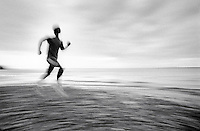 man running on beach, profile (distorted).