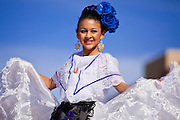 14 JANUARY 2012 - CHANDLER, AZ:    A member of Ballet Folklorico Quetzalli performs at the Multicultural Festival after the naturalization ceremony in Chandler, AZ, Jan. 14. More than 140 people from 21 countries were naturalized as United States citizens Saturday in Chandler. This is the third year Chandler has sponsored a naturalization ceremony in connection with the Dr. Martin Luther King holiday.  PHOTO BY JACK KURTZ
