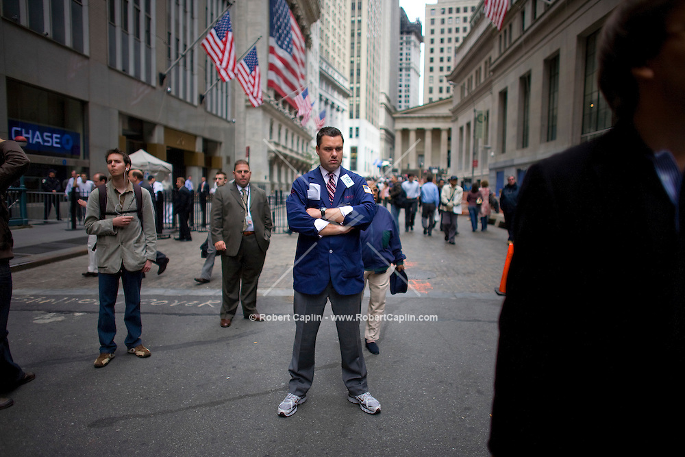 A stock broker outside the New York Stock Exchange during a day in which the American legislative system negotiated a $700 billion bailout plan for the ailing Wall Street financial institutions.
