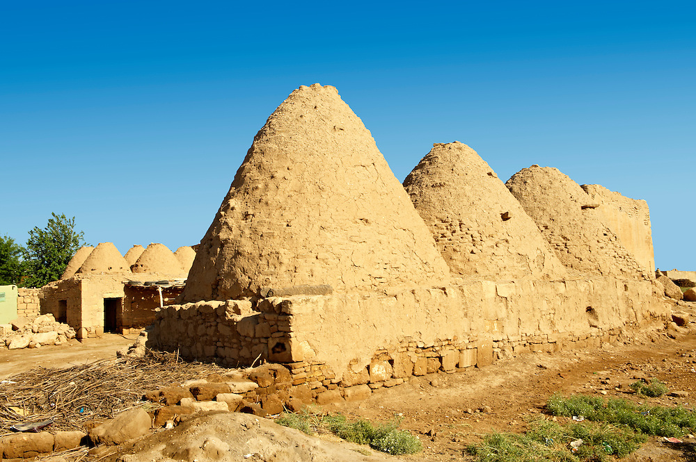 """Pictures of the beehive adobe buildings of Harran, south west Anatolia, Turkey.  Harran was a major ancient city in Upper Mesopotamia whose site is near the modern village of Altınbaşak, Turkey, 24 miles (44 kilometers) southeast of Şanlıurfa. The location is in a district of Şanlıurfa Province that is also named """"Harran"""". Harran is famous for its traditional 'beehive' adobe houses, constructed entirely without wood. The design of these makes them cool inside. 35 .<br /> <br /> If you prefer to buy from our ALAMY PHOTO LIBRARY  Collection visit : https://www.alamy.com/portfolio/paul-williams-funkystock/harran.html<br /> <br /> Visit our TURKEY PHOTO COLLECTIONS for more photos to download or buy as wall art prints https://funkystock.photoshelter.com/gallery-collection/3f-Pictures-of-Turkey-Turkey-Photos-Images-Fotos/C0000U.hJWkZxAbg ."""
