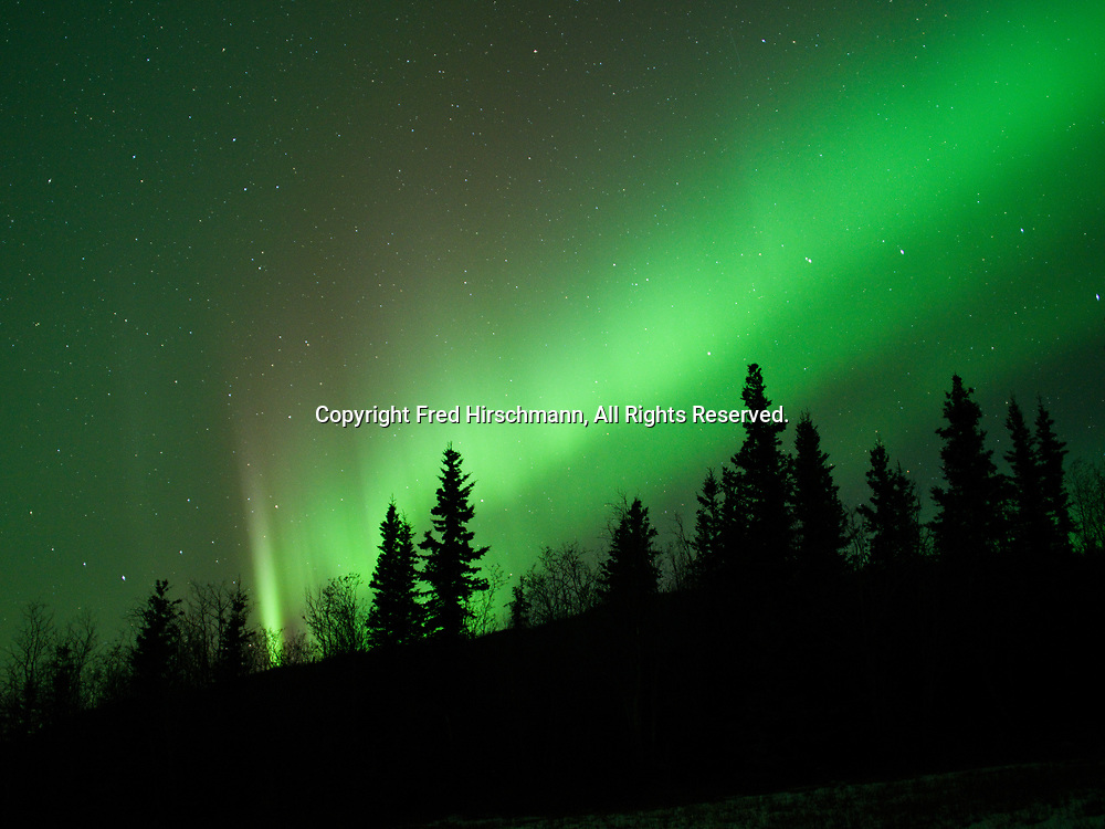 Green Aurora Borealis with hints of red on night of November 4, 2018., Glacier View, Alaska.  Solar wind creating a Class G2 Geomagnetic Storm arriving from a large coronal hole on the sun.