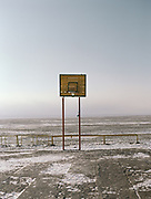 Basketball. A russian era playground near Bulgan town, Mongolia.<br /> <br /> Travels in the Gobi desert region.