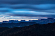 A long exposure captures the motion of storm clouds as they move over the Blue Ridge Mountains in this view from Shenandoah National Park, Virginia.