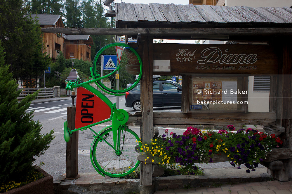 Green bike advertises a local hotel in the Dolomites near La Villa, in Alta Badia, south Tyrol, Italy.