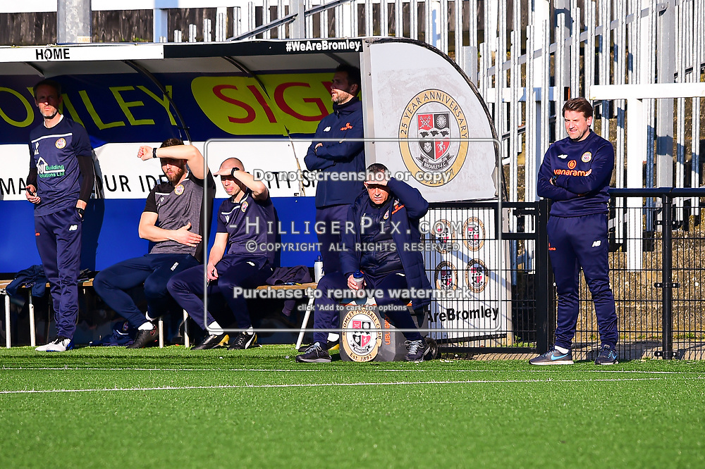 Bromley Manager Neil Smith (2nd right) watches on in the sun.<br /> Bromley | England  | 27 February 2021 | Westminster Waste Stadium<br /> Bromley v Altrincham<br /> Vanarama National League<br /> (Photo: © Jon Hilliger / HilligerPix)