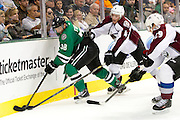 DALLAS, TX - SEPTEMBER 26:  Vernon Fiddler #38 of the Dallas Stars is pinned to the boards by Tyson Barrie #4 and Nathan MacKinnon #29 of the Colorado Avalanche in an NHL preseason game on September 26, 2013 at the American Airlines Center in Dallas, Texas.  (Photo by Cooper Neill/Getty Images) *** Local Caption *** Vernon Fiddler; Tyson Barrie; Nathan MacKinnon