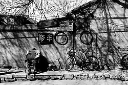 Bicycle repairman and equipment in a hutong in Beijing
