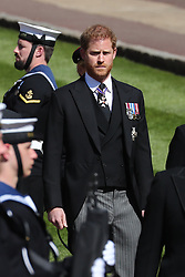 The Duke of Sussex, follows the coffin his grandfather theDuke of Edinburgh, as it passes through the Parade Ground, during his funeral at Windsor Castle, Berkshire. Picture date: Saturday April 17, 2021.